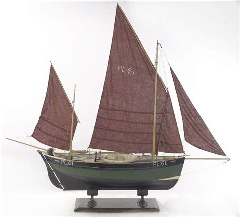 small boat kept on large boat wood boats of western ireland