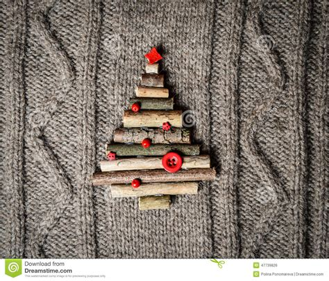 handmade new year decoration warm knitted background with new year tree