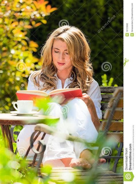Garden Reading Book At Book Reading In The Garden Stock Photography