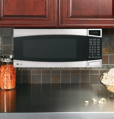 installing ge under cabinet microwave ge pem31smss 1 0 cu ft countertop microwave oven with