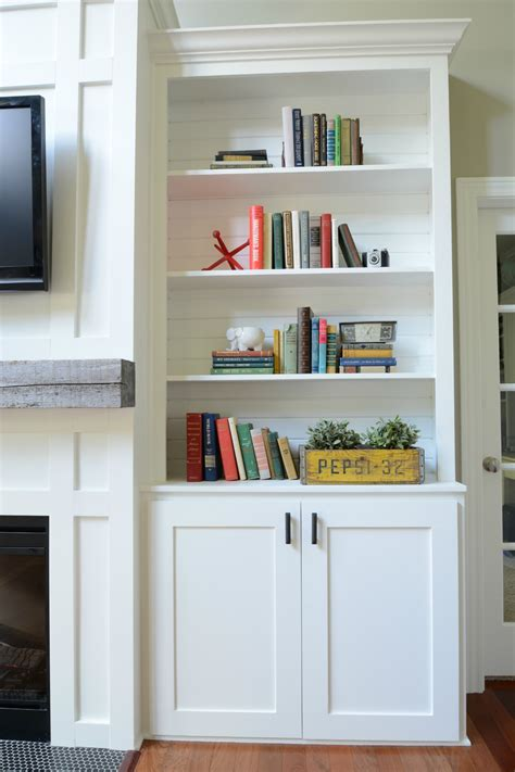 how to decorate bookshelves in living room living room built in cabinets decor and the