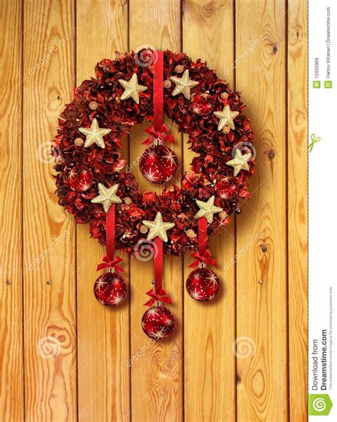 red christmas garland in wooden door royalty free stock