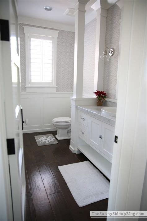 bathroom with dark wood floor 1000 ideas about white vanity bathroom on pinterest