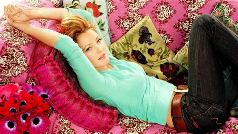 girl lying bed with flowers women jeans couch multicolor flowers actress drew