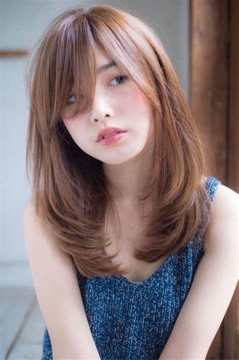 model rambut wanita panjang pendek keriting gaya