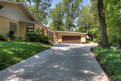 a poured concrete driveway with built in gutters just one option when choosing what type of
