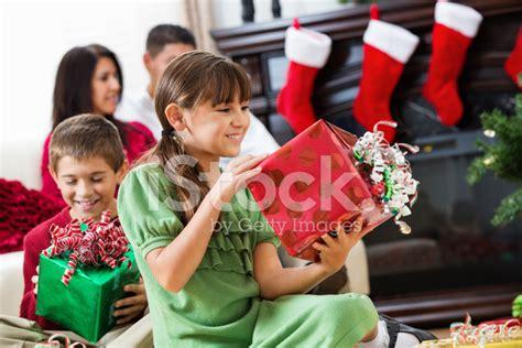 Happy Hispanic Children Opening Christmas Presents With ... Happy Kids Opening Christmas Presents