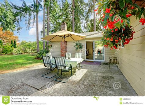 Small Patio Set With Umbrella Countryside House Backyard With Patio Table Stock Photo