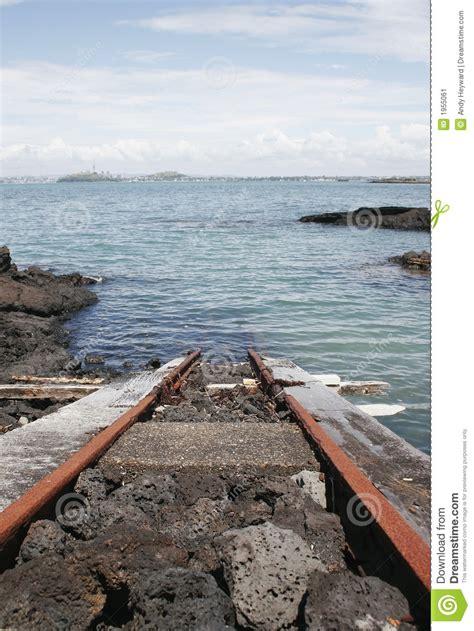 train track   ocean stock image image  beach