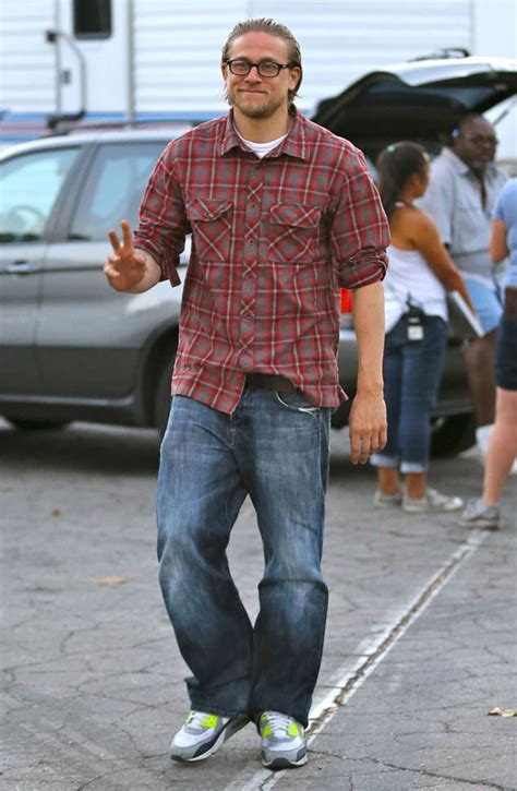 charlie hunnam cant shake his sons of anarchy alter ego as he charlie hunnam on sons of anarchy set same day as lea