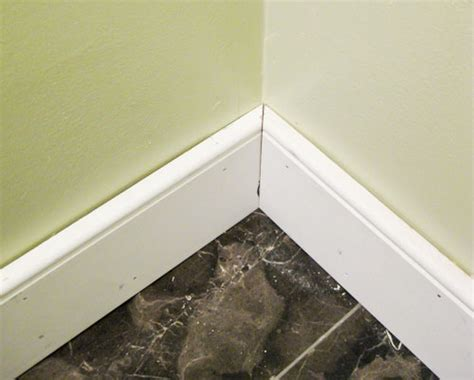 bathroom floor moulding bathroom renovation how to install baseboards trim young house love