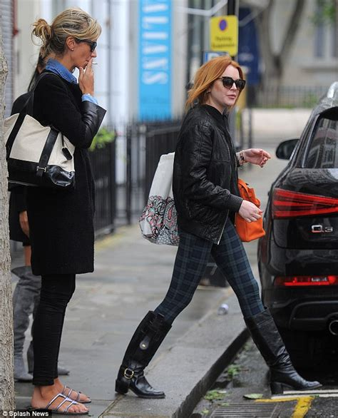 Lindsay Lohan Hangs Out With Jude At The Box by Hervey Shows Much In Semi Sheer Dress At