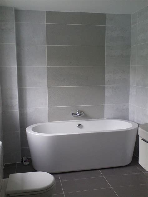 Grey And White Bathroom Tile Ideas Awesome Small Space Grey Bathroom Added Oval White Tub Also Grey Wall Tile In Modern Decors