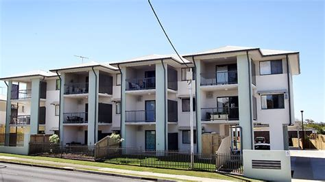 in housing housing units riddled with defects the courier mail