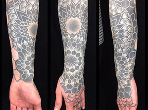 the newest trend solid black tattoos with white