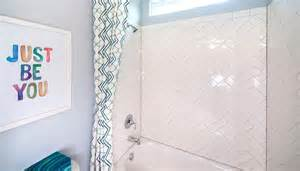 Kids bathroom with herringbone shower tiles contemporary