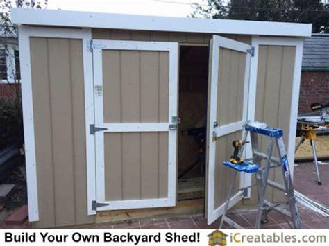 swinging shed doors  locking hardware installed