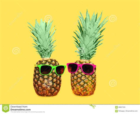 Pineapple Yellow two pineapple with sunglasses on yellow background