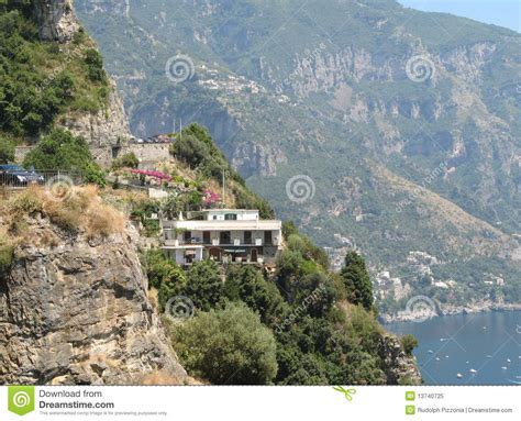 mountainside home by the sea royalty free stock photo