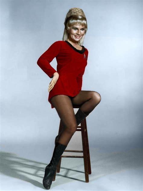 Grace Syari Black by Yeoman Janice Rand Sitting On A Stool Showing Lots Of Leg