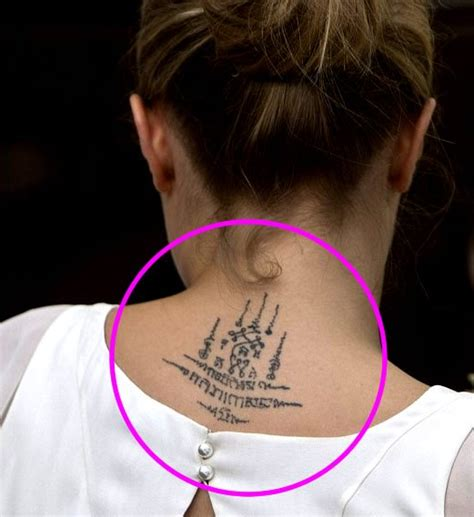 cara delevingne tattoo cara delevingne debuts new neck at poppy s