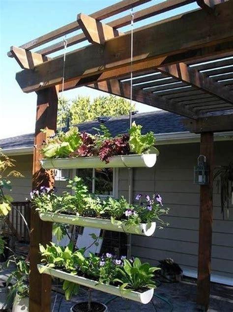 Self Watering Indoor Planters by 10 Ideias Para Criar Vasos Reciclados Para Flores Passo A