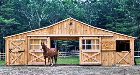 horse barn blueprints cedar board and batten low profile modular barn completed