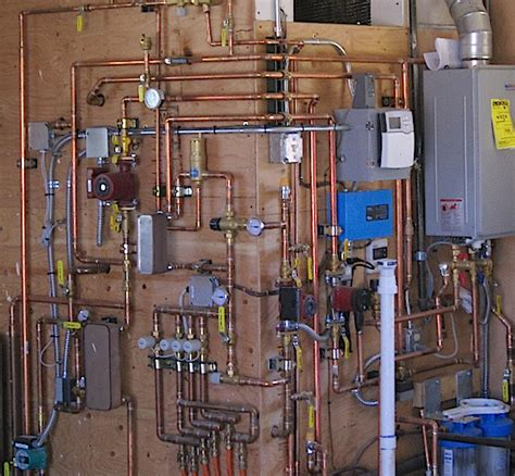 Hydronic Plumbing by Straw Bale Home Meets Energy Efficiency Challenges