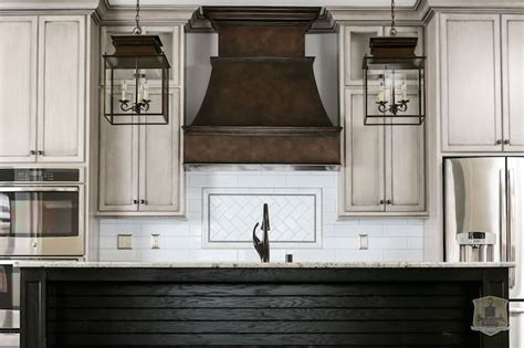 brick backsplash and copper hood would look great with french copper hood transitional kitchen stonecroft homes