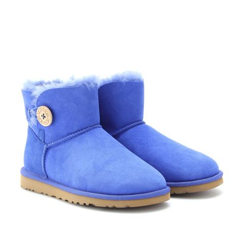 ugg mini bailey button shearling lined shoe boots in blue