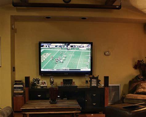 projectors vs tvs should you ditch your flat screen for a projector