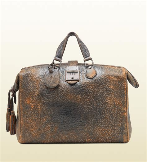 Guc Ci Leather lyst gucci goldmark grainy leather duffle bag in brown