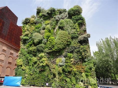 Vertical Garden Madrid Blanc S Lush Vertical Garden Is A Green Oasis In