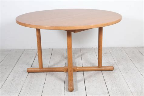 round dining room tables with extensions oak round extension table in the style of charlotte
