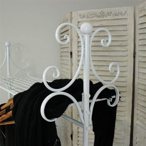white ornate vintage style home hangin clothes rail