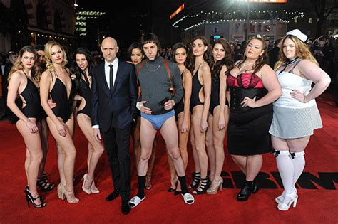 sacha baron cohen grimsby sacha baron cohen surrounded by swimsuit models and wife