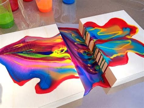 pouring acrylic paint on canvas acrylic pouring medium connecting two wood panels