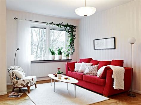 red couch white pillows red living room decor red sofa
