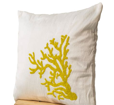 Decorative Coral Pillows by Decorative Pillow With Yellow Coral On Ivory White By