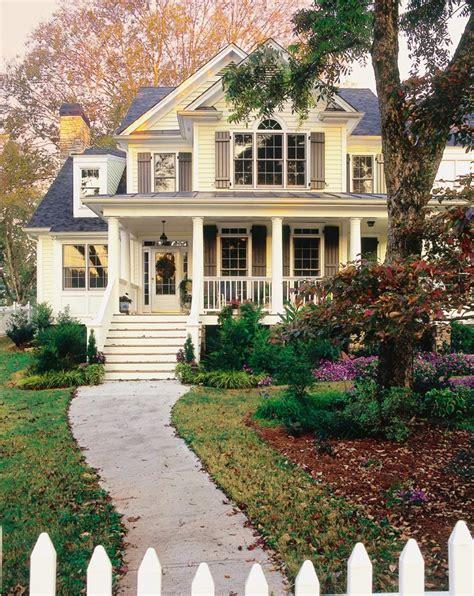 yellow and white houses embarking on suburbia