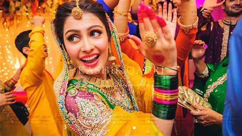 multi color pakistani mehndi dresses for bridals