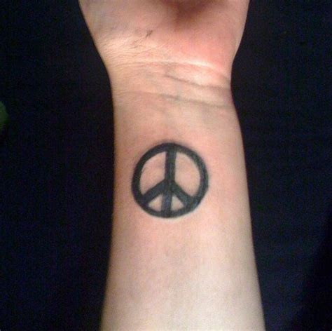 peace tattoos on wrist 36 attractive peace wrist tattoos