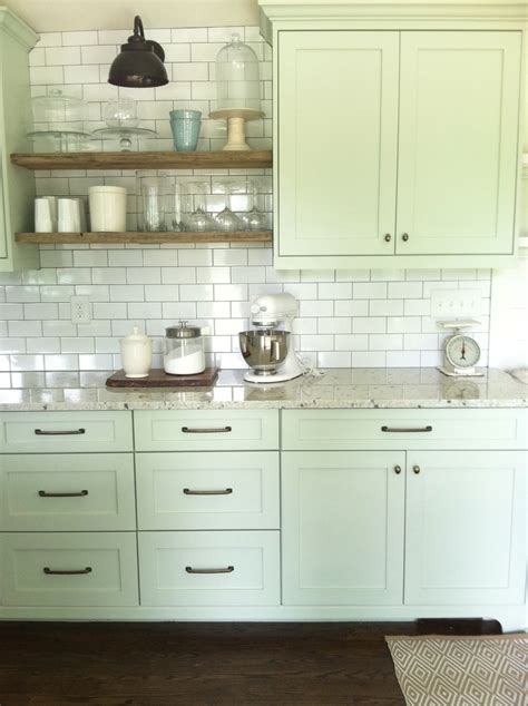 stove opening between cabinets nice cabinet color and full wall of subway tile with open