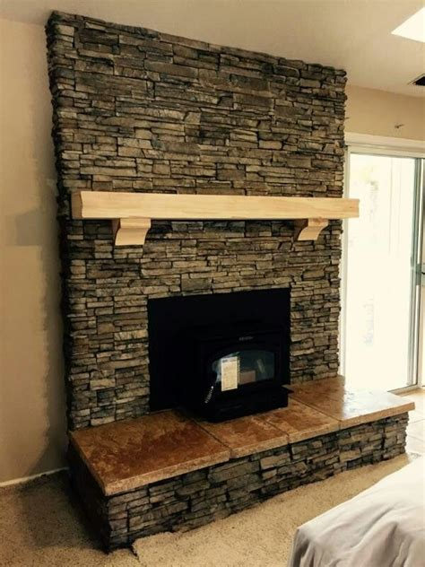 el dorado nantucket stacked stone travertine hearth  rustic mantle