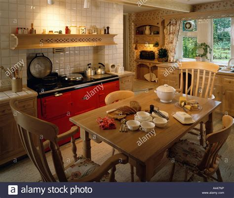 wooden country kitchen aga oven in traditional country kitchen with wooden