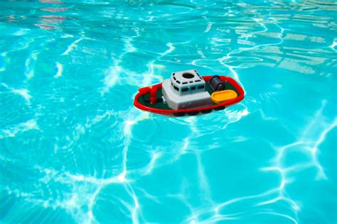 toy boat picture toy boat in pool free stock photo public domain pictures