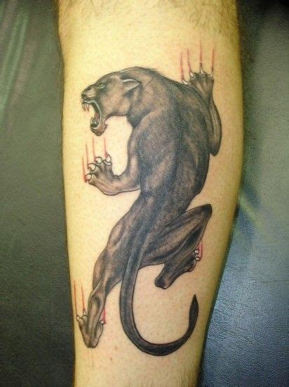 crawling panther tattoo climb up panther on leg tattoos