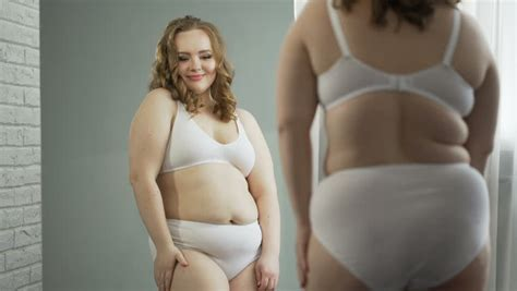 woman with the biggest thing in her vigina girl looking in mirror at big belly and fat hips needs