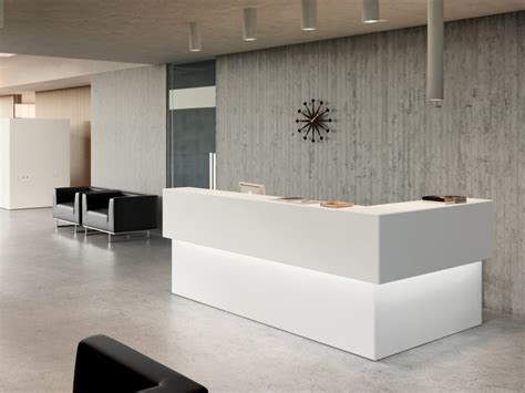 White Backlit Ikea Reception Desk With Grey Textured Wall