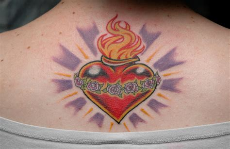 tattooed heart tattoo parlour sacred heart by tuffincr on deviantart